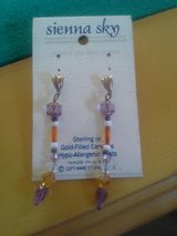 Purple/orange earrings in Travis AFB, California